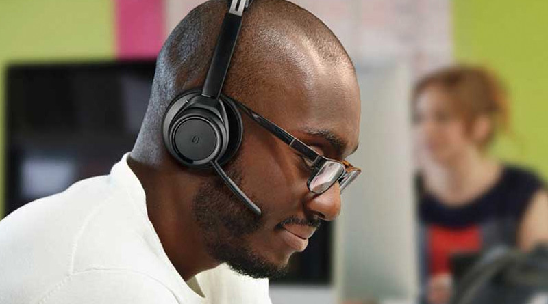 man wearing Plantronics headset