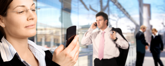 Businesspeople are calling on mobiles in front of a modern office building.