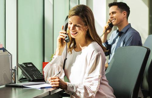 Woman Talking on Polycom VVX 150